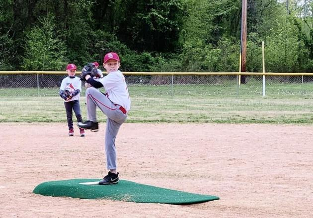 Brody Dockery of the Hood's Market Cardinals on the mound.