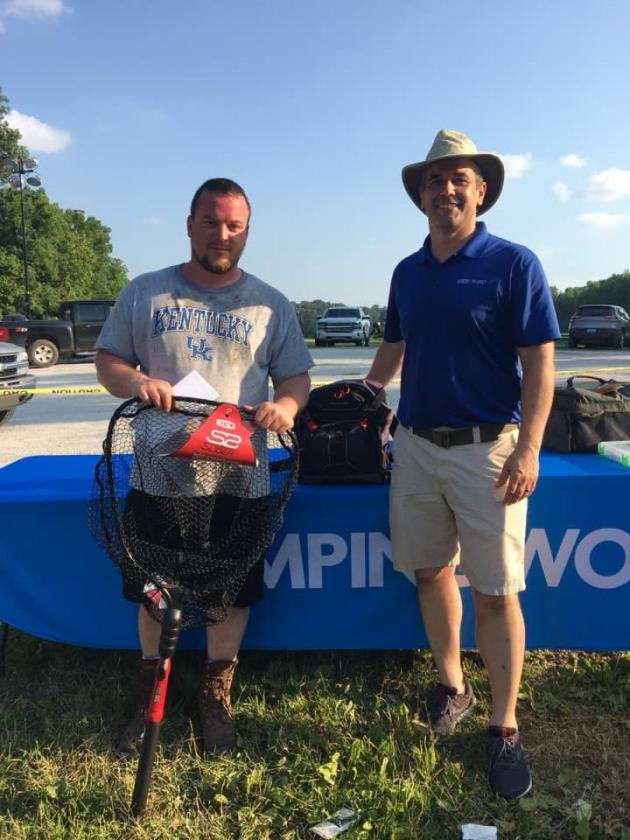 Fisherman Dustin Coots and Gander Store Manager Chris Robbins