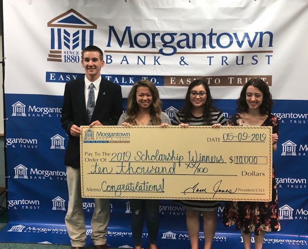 The four scholarship winners.  From left to right: Luke Jacobs, Dana Newland, Julia Bonilla, and Amy Poff.