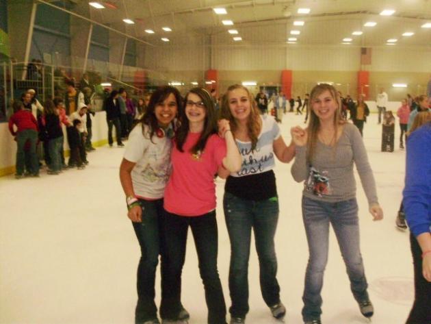 Sadie Daniel, Krystal Neal, Sydney Wilson, and Candace Ibarra ice skating