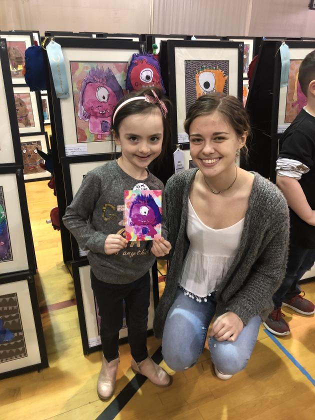 Nora Lindsey (Kindergarten) with Camryn Newland (11th grade)