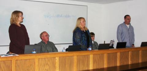 Swearing in of school board members Karen Evans, Debbie Hammers, and Charles Price.