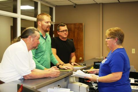 Roger Givens, Cody Donaldson, and Josh Hampton turn in the petition to County Court Clerk Sherry Johnson