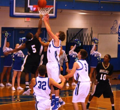 Trevor Jenkins rebounds.