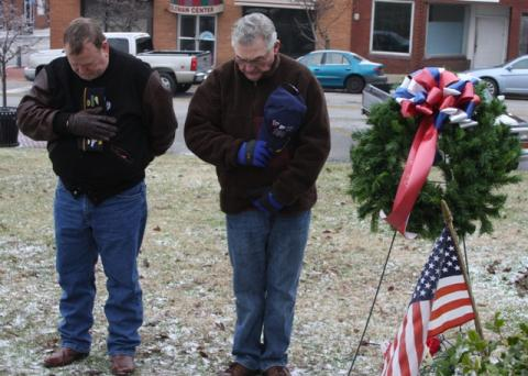 P.R. Webster of the American Legion and Sharone Nash of the VFW assist in the laying of the wreath.