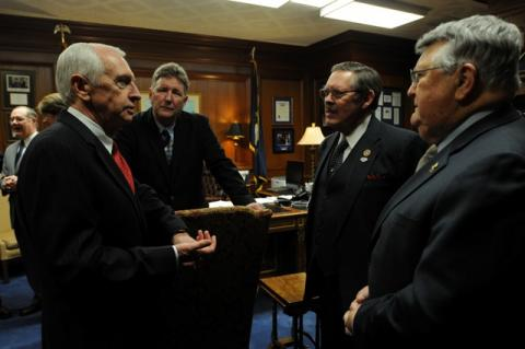 Rep. C.B. Embry, Jr. (second from right), R-Morgantown, joined by Rep. Ron Crimm (first from right), R-Louisville, talk with Kentucky Governor Steve Beshear shortly before the Governor delivered his budget address during the 2014 Regular Session.  Rep. Embry was one of a small group of House and Senate members selected to escort the Governor to House chambers for his address, which took place on Tuesday, January 21st. (Photo: LRC Public Information)