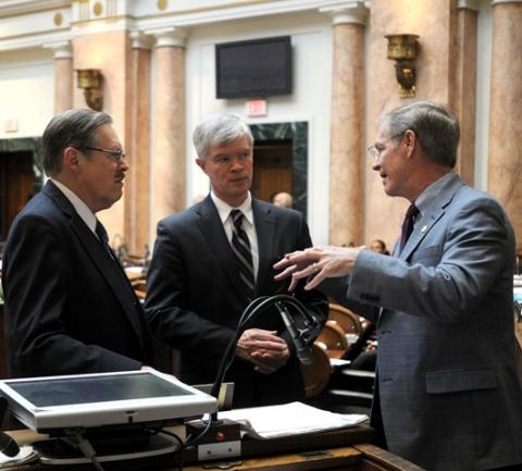 Rep. C.B. Embry, Jr., R-Morgantown (left); Rep. Dwight Butler, R-Harned (center); and Rep. Brad Montell, R-Shelbyville talks during a break in the Kentucky House of Representatives. (Photo: LRC Public Information)