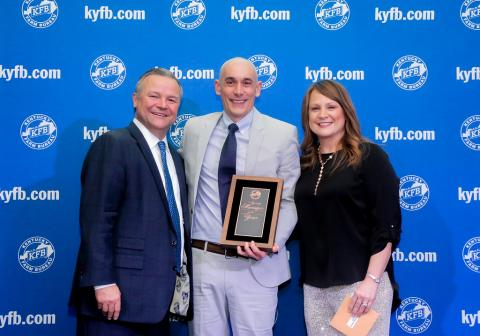 Chuck Osborne, KFB Insurance Vice President of Agency Support & Marketing (left), and Jessica Sullivan, KFB Insurance Agency Support & Marketing Manager for District Two (right), present James Runion (center) with the 2019 District Two Agency Manager of the Year Award.