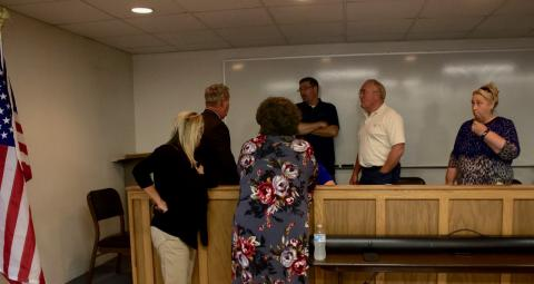 Supt. Howard, Board members and staff discuss things following Tuesday's meeting.