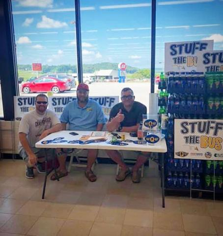 WLBQ Radio DJs Cody Donaldson, Brent Clark and Josh Hampton hosted live shows at the local IGA store in Morgantown for the Stuff the Bus Foundation.