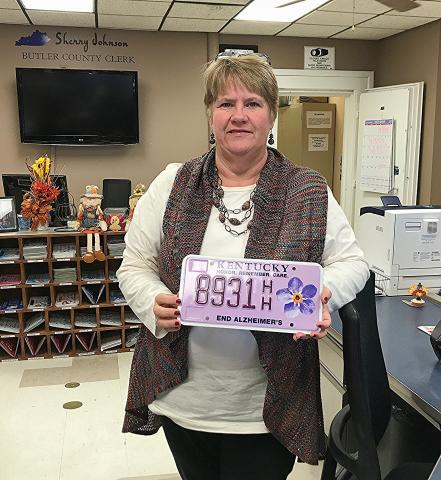 Butler County Clerk Sherry Johnson shows the specialty plate.