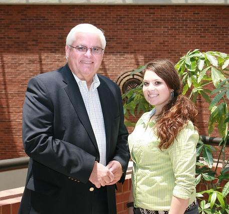 Tori Fugate (right), of Morgantown, KY, is greeted by Mark Haney, president of Kentucky Farm Bureau (left), during the 2012 Institute for Future Agricultural Leaders (IFAL).