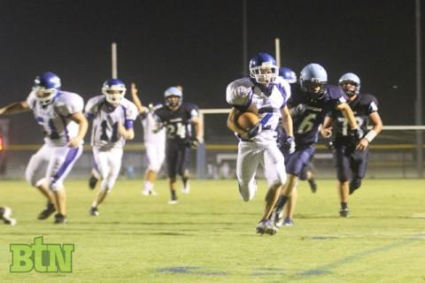 Havens takes the ball to the end zone.