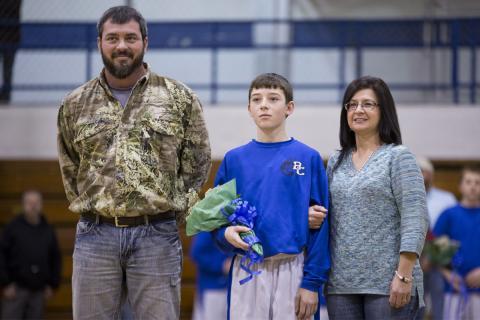 Justin Elms with parents Jason and Debbie Elms