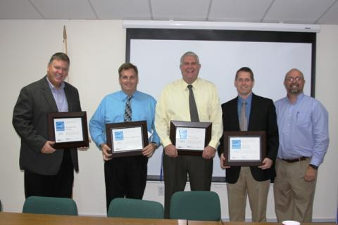 Principals: Jeff Jennings, Micheal Gruber, Greg Woodcock, and Robert Tuck were presented certificates from Jimmy Arnold.
