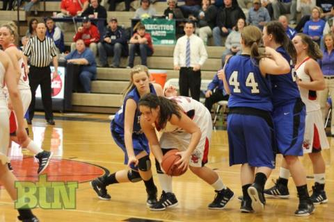 Lady Bears battle for the ball.