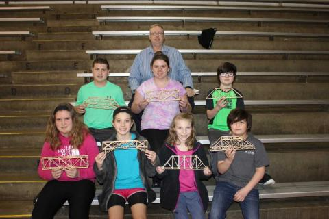 2018 Bridge Building Team L-R: First Row -Savannah Coin, Taylor Leach, Brooklyn Smith, Jayden Jenkins; L-R: Second Row - Caleb York, Lita Litten, Jameson Findley: Top Row - Bridge Building Coach Dennis McCrocklin
