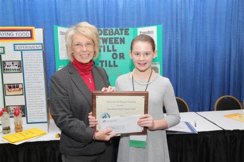Vicki Bryant of the Kentucky Farm Bureau State Women's Committee presents Harmony Taylor an award of recognition for her participation in the 2019 Science in Agriculture program.