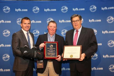 Shane Wells, President of Butler County Farm Bureau (center), accepts the award from John Sparrow, Chief Executive Officer of KFB Insurance Companies (left), and David S. Beck, Executive Vice President of the KFB Federation (right), during a December 1 recognition and awards program.