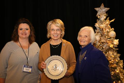 Sherri Kirby & Betty Farris of Butler County Farm Bureau Women's Committee, accepts the 2019 Gold Star Award of Excellence from Vicki Bryant, chair of Kentucky Farm Bureau state Women's Committee. The award was presented during a December 6 recognition program at the 100th Kentucky Farm Bureau annual meeting.