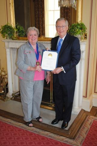 Sen. McConnell congratulates Jefferson Award recipient, Christine Porter Coleman of Morgantown.