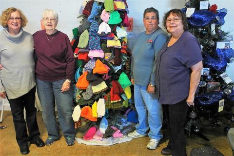 Brenda Jenkins, Beverly Hayes, Linda Pendley and Christine Bratcher set up the tree