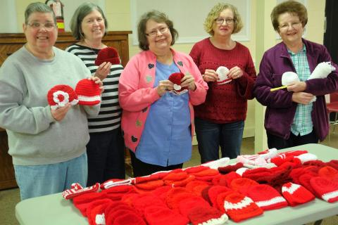 From left Linda Pendley, Sibyl Shelton, Christine Bratcher, Brenda Jenkins and Betty Phelps with the hats they made. Not pictured are Jonell Johnson, Kathy Vernon and Ann Bratcher