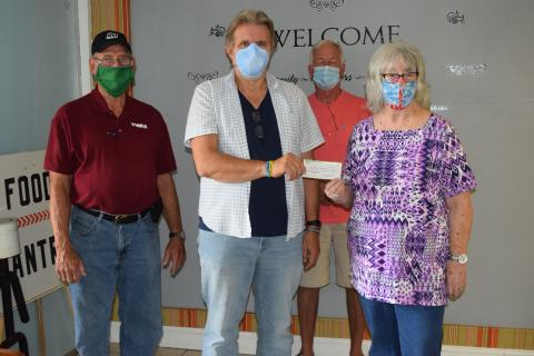 Accepting the donation from Paradise Chapter president Patricia Cobb is Garry McKinney of The Morgantown Mission. Also present in the picture is Gary Southerland, past president of the Paradise Chapter.