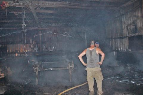 Dunaway Timber employee Darrell Glenn (with back turned) discovered the fire Thursday night.