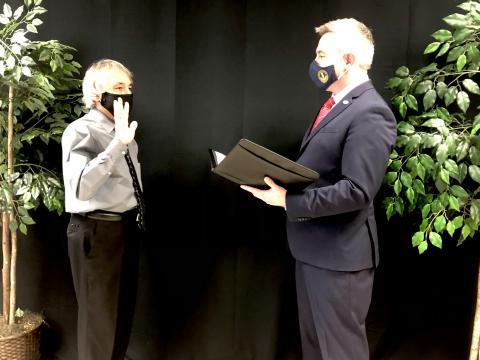Stevie Givens being sworn in by Ryan Quarles