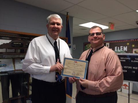 Mr. Greg Woodcock (left) Morgantown Elementary Principal and Mr. J. Chad Flener (right) are shown with the certificate awarded to Morgantown Elementary by the Kentucky Board of Education