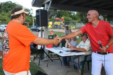 Chamber President James Runion congratulates Joey Summers on catching the largest catfish of the tournament.  Summers was also the top money prize winner at $2,100.