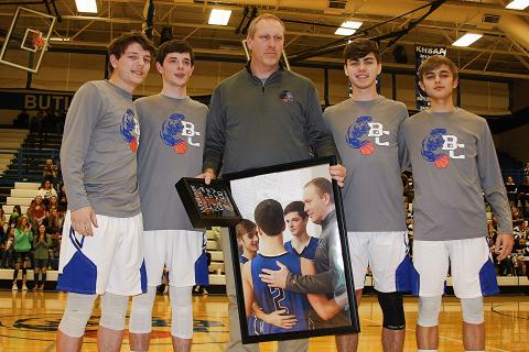 The senior Bears presented Coach Calvin Dockery with a framed photo.