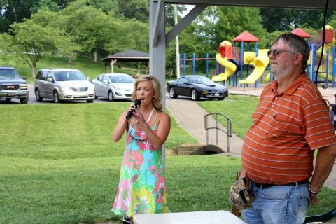 Hannah Renfrow performs the National Anthem to kick-off the 2015 Catfish Festival.  At right is Randell Gaskey, Chamber of Commerce vice-president