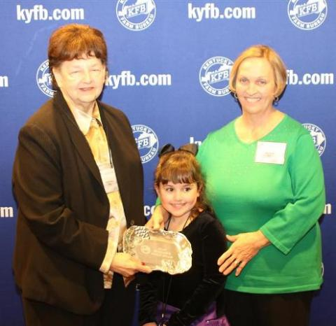 Rita Drake, chair of the BC Farm Bureau Women's Committee (right) and granddaughter Maggie Drake, accepts the 2013 Gold Star Award of Excellence from Phyllis Amyx, chair of the KYFB state Women's Committee (left).
