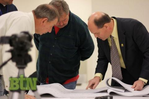 Councilman Gary Southerland, Gigi Rose, and Greg Meredith look over plans.