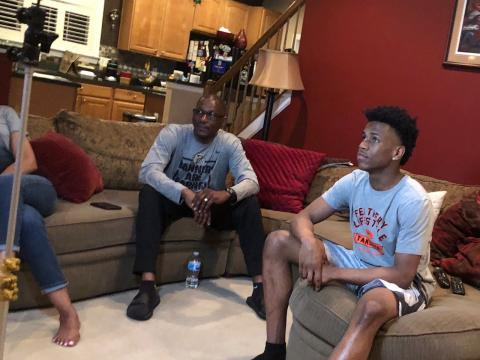 Junior point guard Jeremy Roach watching TV with his father, Joe. Roach was the first point guard in the 2020 recruiting class offered by John Calipari. (Samantha Pell Photo)