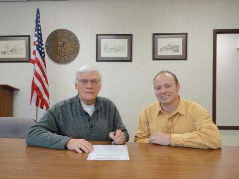 Judge-Executive David Fields and Adam Massey