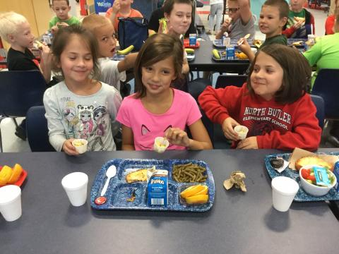 NBES students enjoy food from their garden.