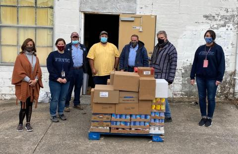 Photo Cutline: A group of realtors from Realtors® Hope for Hunger helped with food distribution in Butler County.