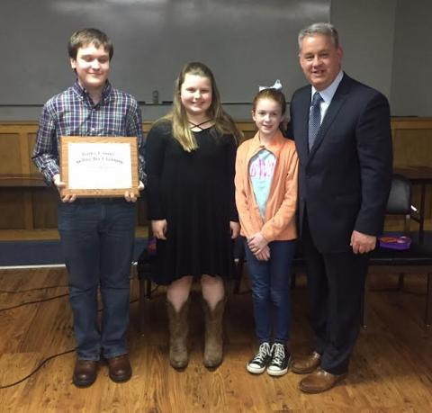 Carter Hawkins, Morgan McKinney, Briley Webster, and Butler County Schools' Superintendent Scott Howard