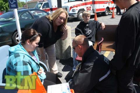EMTs evaluate injured students in the triage area