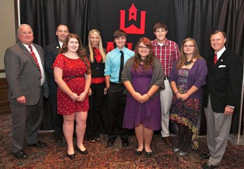 Butler County High School: WKU honored six students from Butler County High School. From left: principal Patrick O'Driscoll, counselor Duane Curry, Laura Hunt, Sierra Fields, Austin Vonaxelson, Kaley Burden, Alex Hall, Mahkala Burden, WKU President Gary Ransdell. (WKU photo by Clinton Lewis)