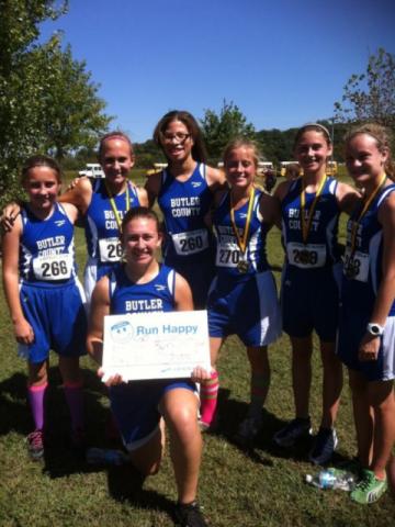 Varsity girls team with 2nd place troph at Gatorland Run  L to R Hannah Logan, Chanda Hampton, Amy Rogers, Dalys Bishop, Maranda Pierson, Hannah Perry, Olivia Neighbors