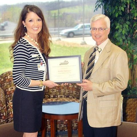 Kaitlin Harrison, RD, LD is congratulated by Wayne Meriwether, MHA, Chief Executive Officer at Twin Lakes Regional Medical Center upon being named the 2014 Kentucky Young Dietitian of the Year by the Kentucky Academy of Nutrition and Dietetics.