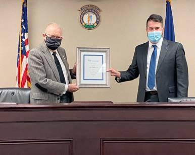 Pictured left to right: Senator C.B. Embry (R-Morgantown) and Todd Blevins, Kentucky State Director for the HSUS.