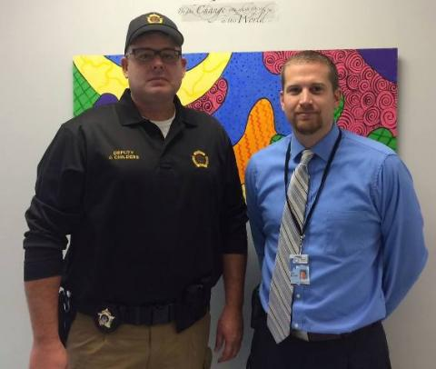Deputy Jaman Childers and Josh Belcher, NBES Principal