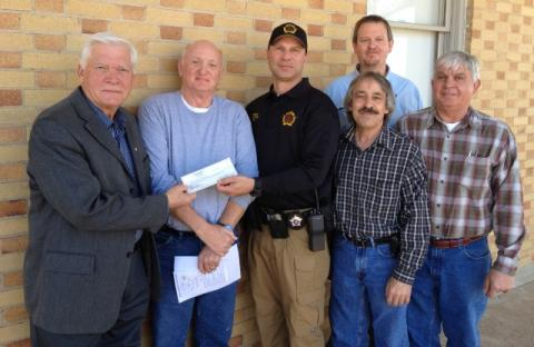 Sheriff Scottie Ward gave the squires a check for $22,632.74 for the 2013 settlement  of the sheriff's office.