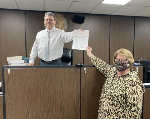 Butler County Clerk Sherry Johnson presents $239,968.48 check to Judge Tim Flener