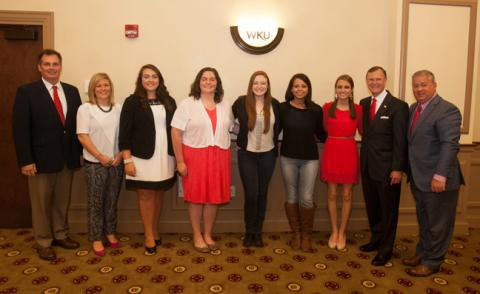 WKU honored five students from Butler County High School on Oct. 14. From left: Michael Gruber, counselor Hanna Southerland, Alison Kurfiss, Brittney Gruber, Emily Rich, Brittany Qualls, Haley Adkins, WKU President Gary Ransdell, superintendent Scott Howard. (WKU photo by Clinton Lewis)